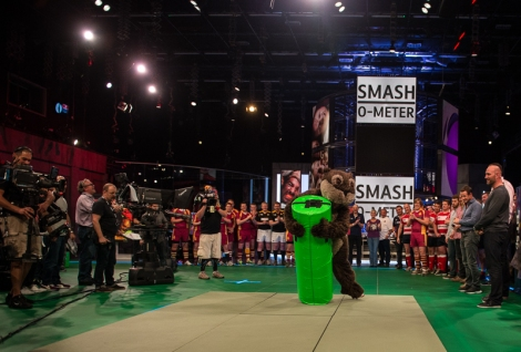 Derek the Otter, of the Exeter Chiefs, tries his hand at the Smash-O-Meter